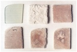 Fig. 8. Samples of a model glass: (top left) untreated state; (top                             centre) after 10 weeks of weathering; (top right and below) as top                             centre, but after removal of the corrosion crusts.